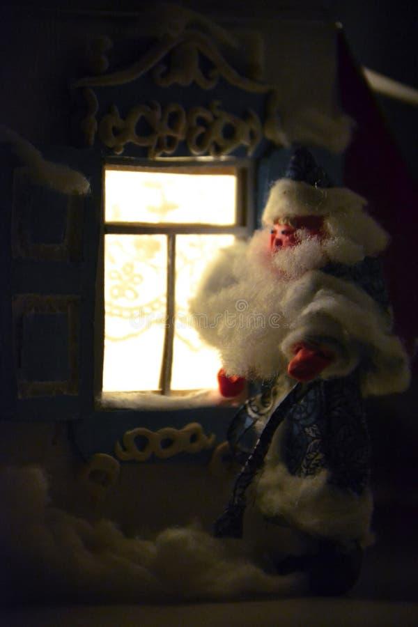 Magic New Year night and Santa stock image