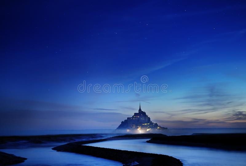 Magic of the night at Mont Saint Michel stock image