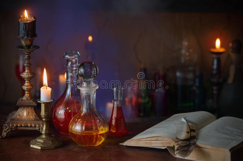 Magic potion, ancient books and candles royalty free stock images