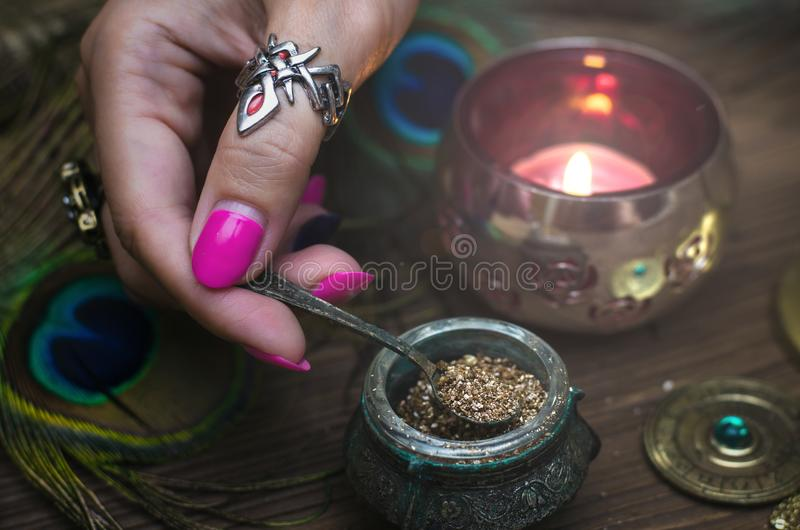 Magic potion. Witchcraft. Magic qure. Shaman. Witch prepares a magic potion. Fortune teller table. Divination. Witchcraft royalty free stock photos