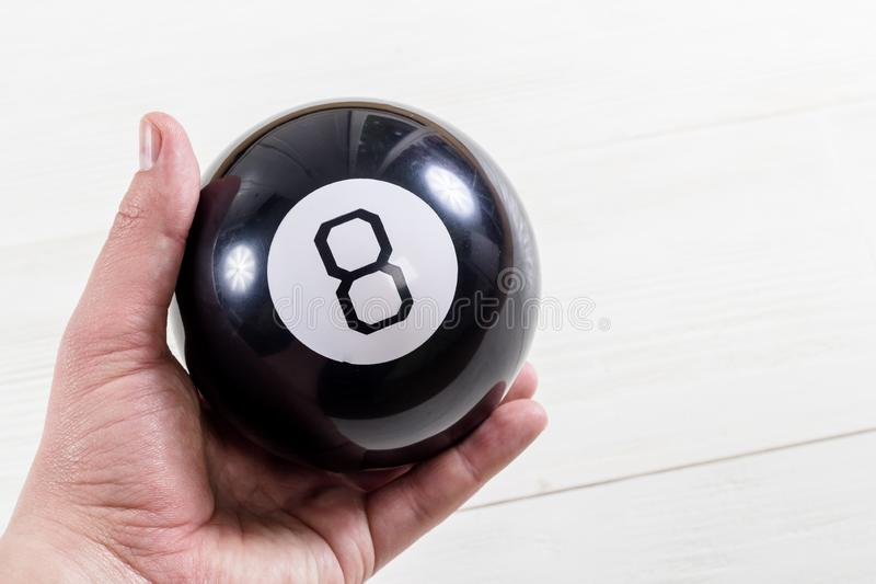 Magic prediction eight ball in hand royalty free stock photo