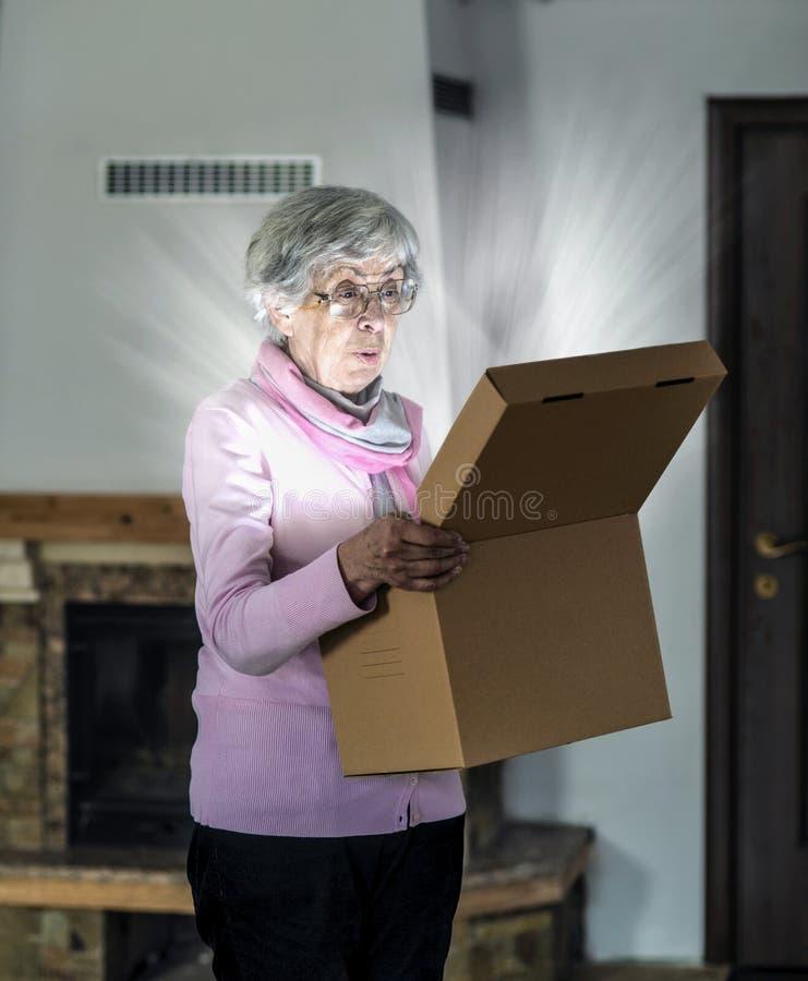 Magic present. Woman opening a magic box stock images