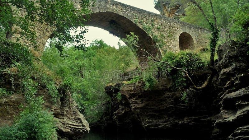 Magic Roman bridge in beautiful river. Magical and beautiful landscape of rivera decorated by a Roman bridge royalty free stock photos