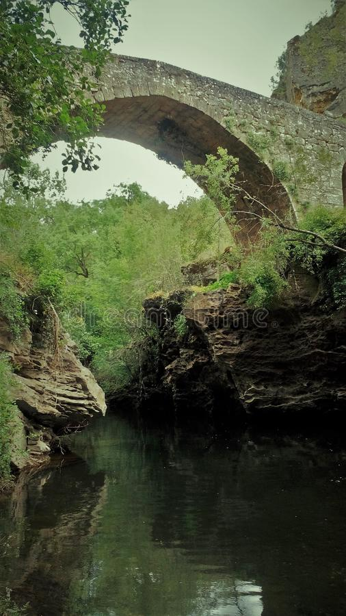 Magic Roman bridge in beautiful river. Magical and beautiful landscape of rivera decorated by a Roman bridge stock photography
