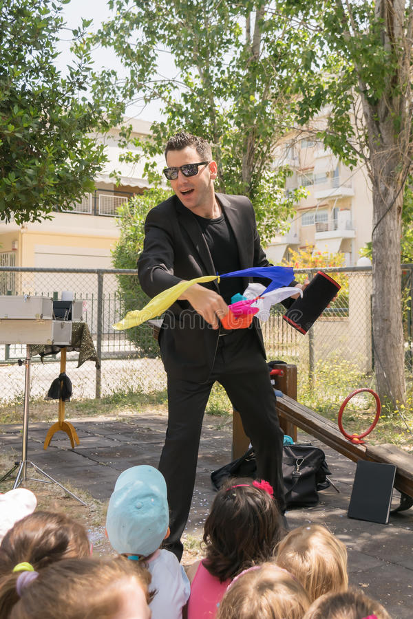 Free Magic Show With Tristan At A Kids Party. Stock Photography - 57095802