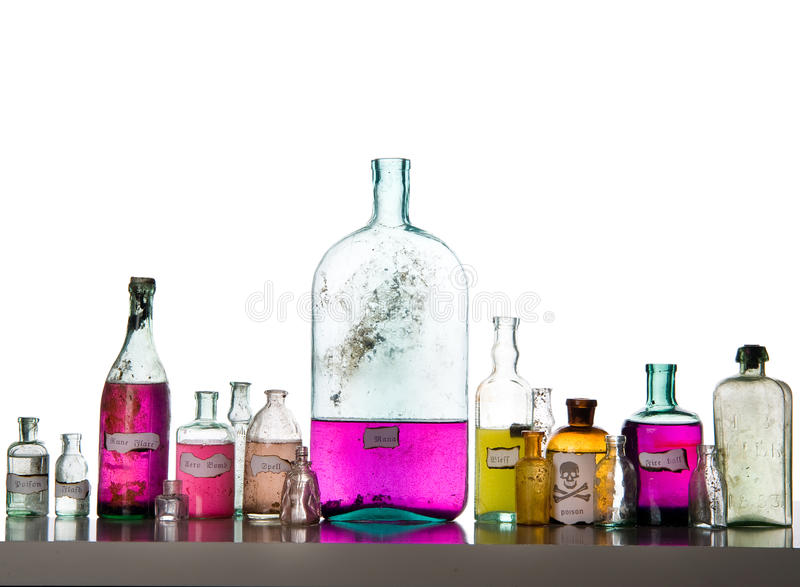 Magic spells in antique bottles. Magic spells. Antique bottles over white background royalty free stock image
