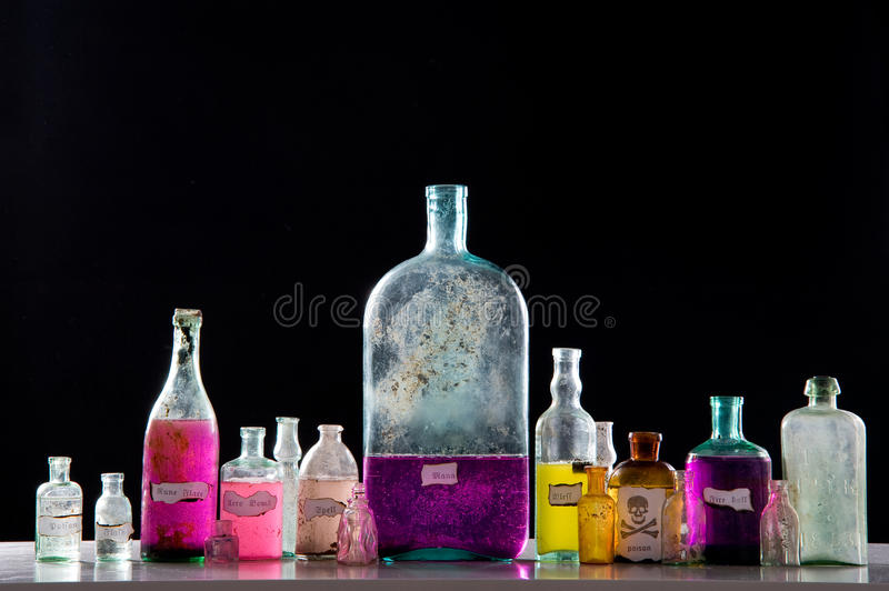 Magic spells in antique bottles royalty free stock image