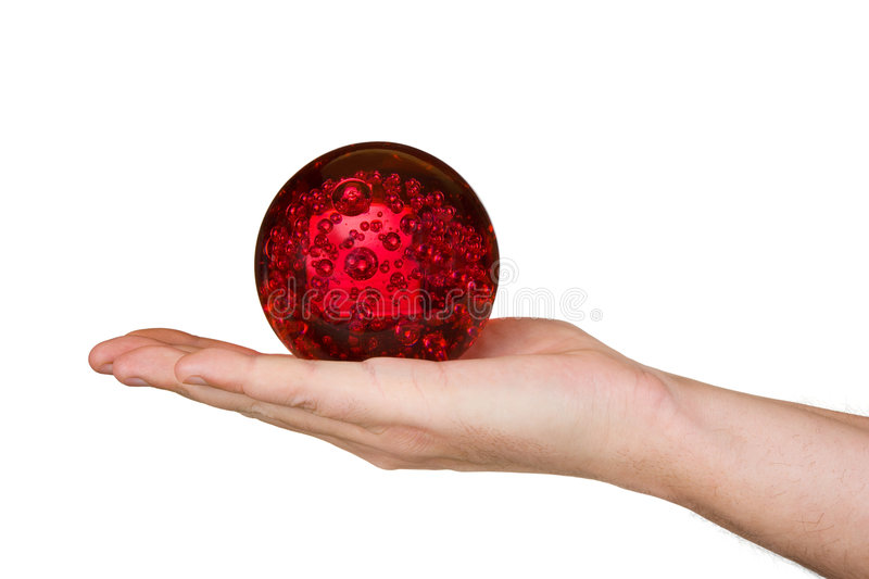 Magic sphere in hand. Isolated on white background royalty free stock images