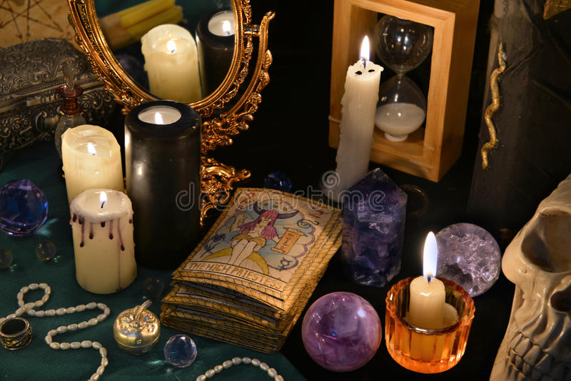 Magic still life with the Tarot cards, mirrow and burning candles royalty free stock photo