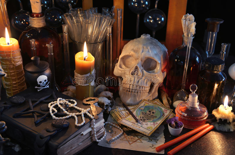 Magic still life with tarot cards, skull and burning candles stock image