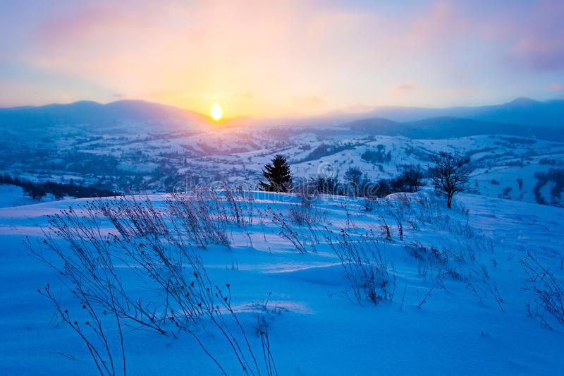 Magic in winter. Cold morning in mountains, beautiful landscape. Sun shines over hills royalty free stock photos