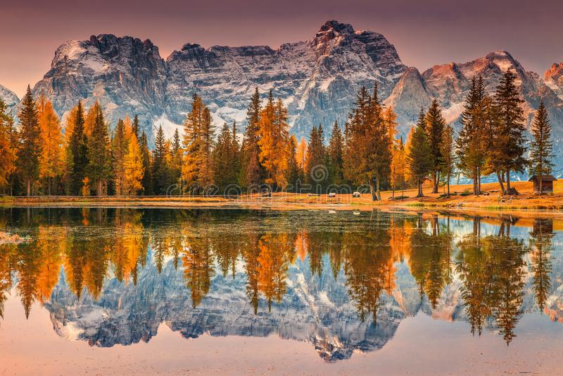 Magical alpine lake in Dolomites mountains, Antorno lake, Italy, Europe. Spectacular sunrise and wonderful alpine Antorno lake with high Sorapis mountains group stock images