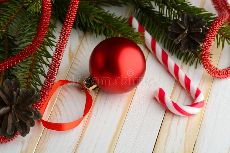 Magical arrangement of candy cane with pine fresh branches and Christmas decor. stock image