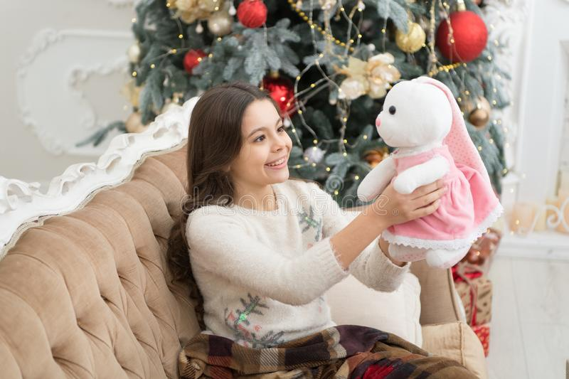 Magical atmosphere. Winter wonderland. Best time of the year. Adorable girl play with toy in christmas eve. Cozy concept. Smiling child enjoy winter holidays stock images