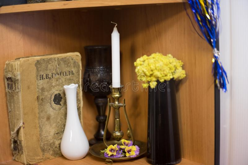 Magical attributes, candle sorcerer. Magical attitudes, the sorcerer`s candle in the evening room before the rite royalty free stock photography