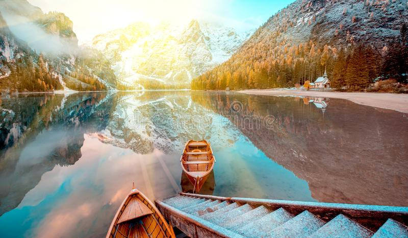 Magical beautiful fairy autumn landscape with boats on the lake royalty free stock photography