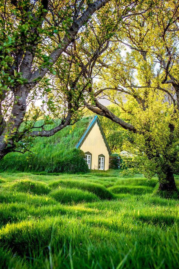 Magical charming beautiful landscape with turf roof church in old Iceland traditional style and mystical cemetery in Hof,. Skaftafell, Vatnajokull National Park stock images