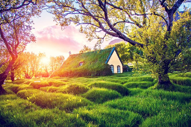 Magical charming beautiful landscape with turf roof church in old Iceland traditional style and mystical cemetery in Hof,. Skaftafell, Vatnajokull National Park stock photo