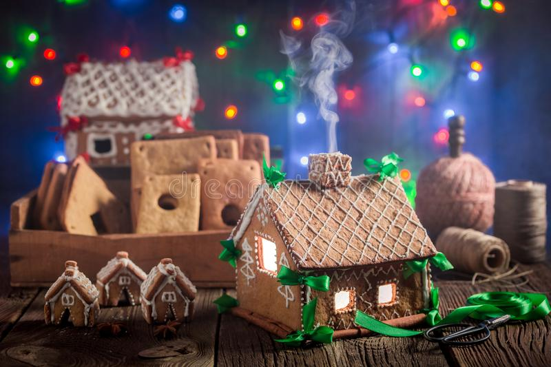 Magical Christmas gingerbread cottage and Christmas lights stock images