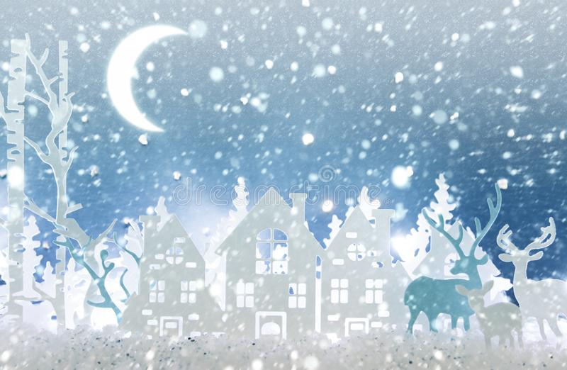 Magical Christmas paper cut winter background landscape with houses, trees, deer and snow in front of night starry sky background. Magical Christmas paper cut royalty free stock photography