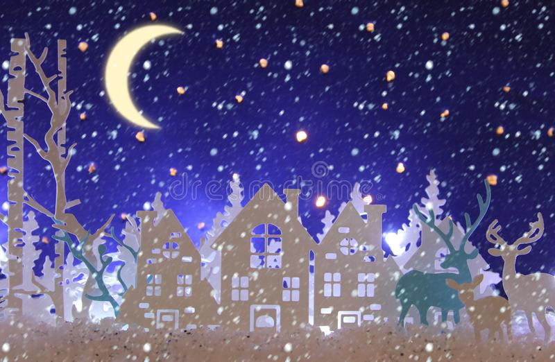 Magical Christmas paper cut winter background landscape with houses, trees, deer and snow in front of night starry sky background. Magical Christmas paper cut stock image