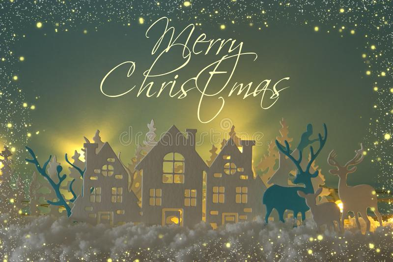 Magical Christmas paper cut winter background landscape with houses, trees, deer and snow in front of gold lights background. Magical Christmas paper cut winter royalty free stock images