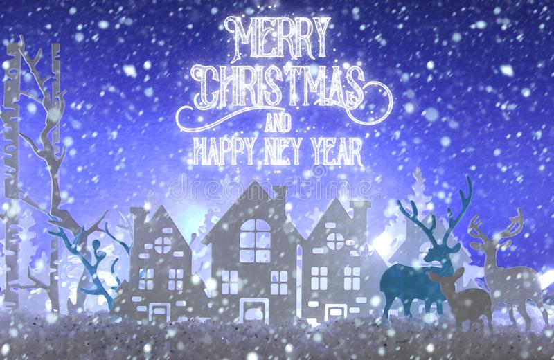 Magical Christmas paper cut winter background landscape with houses, trees, deer and snow in front of white lights background. Magical Christmas paper cut royalty free stock photos