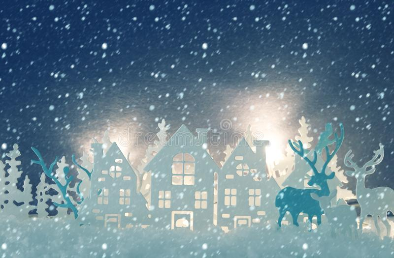 Magical Christmas paper cut winter background landscape with houses, trees, deer and snow in front of white lights background. royalty free stock images