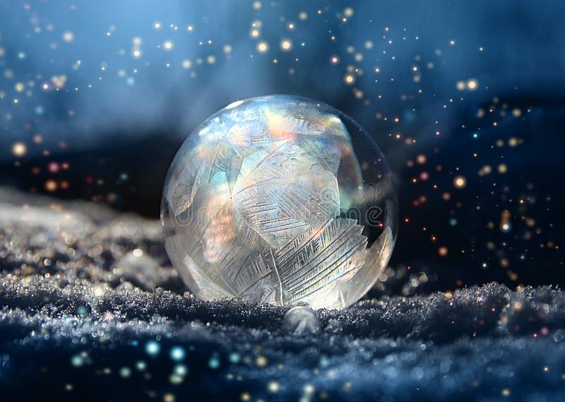 Magical color glitter frostball winter snow royalty free stock images