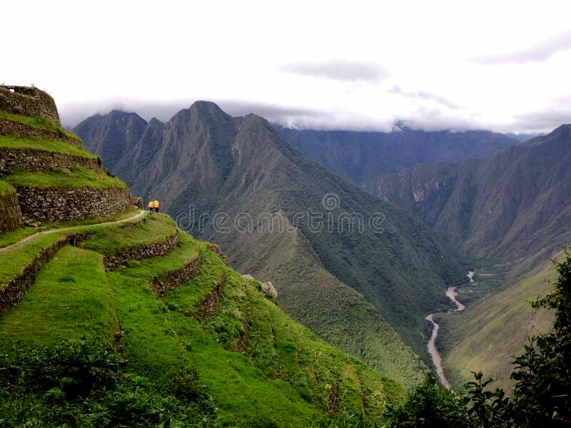 Porters on the Inca Trail to Machu Picchu, Peru South America. Magical day trekking on the Inca Trail in Peru en route to Machu Picchu. Two porters wind round stock image