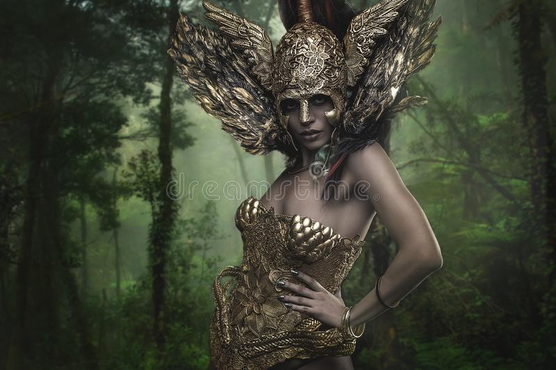 Magical, Deity, beautiful woman with green hair in golden goddess armor. Fantasy warrior stock image