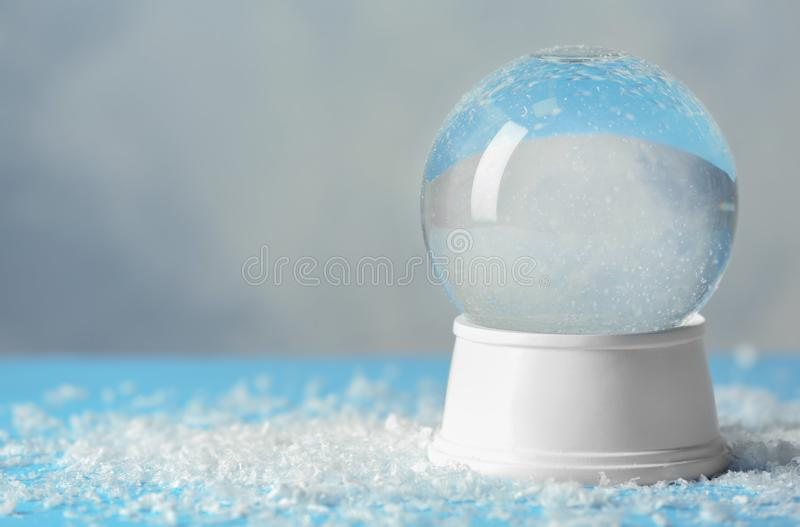 Magical empty snow globe on table. Space for text royalty free stock photos
