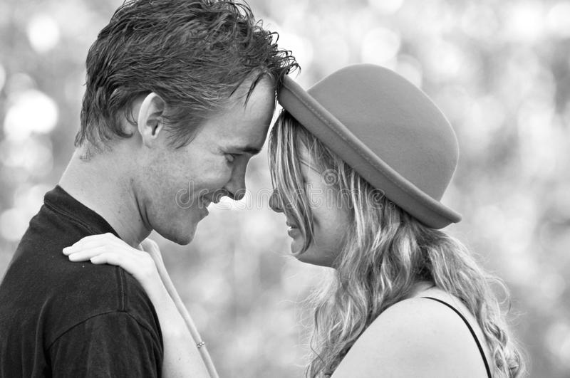 Magical feeling of being young and falling in love for first time. An intimate candid outdoors portrait of two lovely sweet and tender young people falling in royalty free stock photos