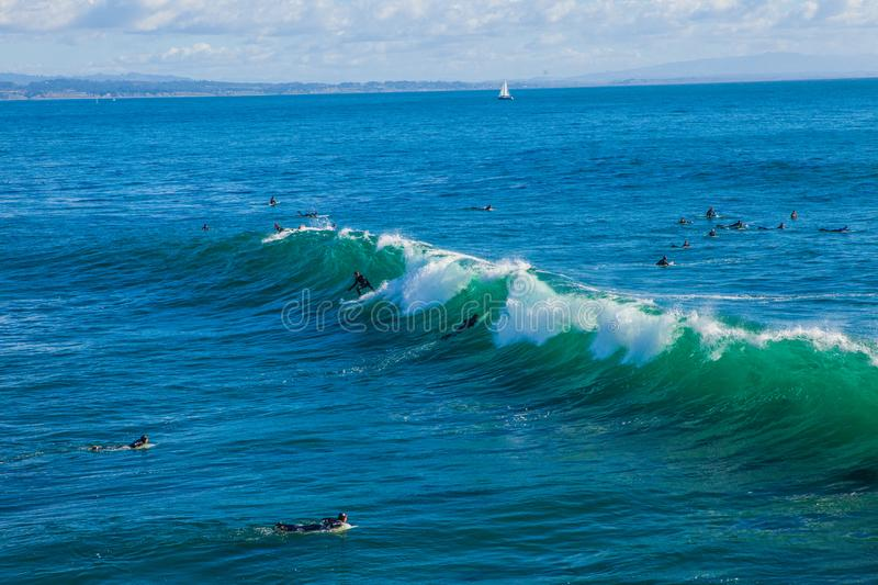 The magical huge waves in the bay of santa cruz make this a surf. Santa Cruz, United States - January 27 , 2013 :  Surf capitol of the US. Only the bravest stock photography