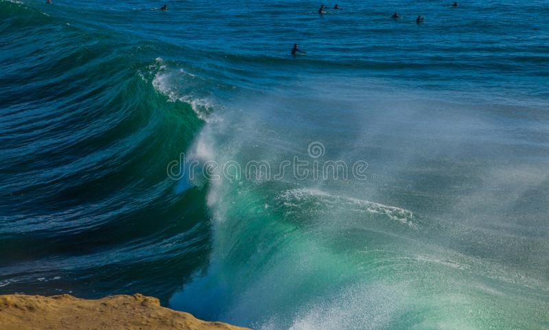 The magical huge waves in the bay of santa cruz that are rolling. Santa Cruz, United States - January 27 , 2013 :  Surf capitol off the US. Only the bravest royalty free stock image
