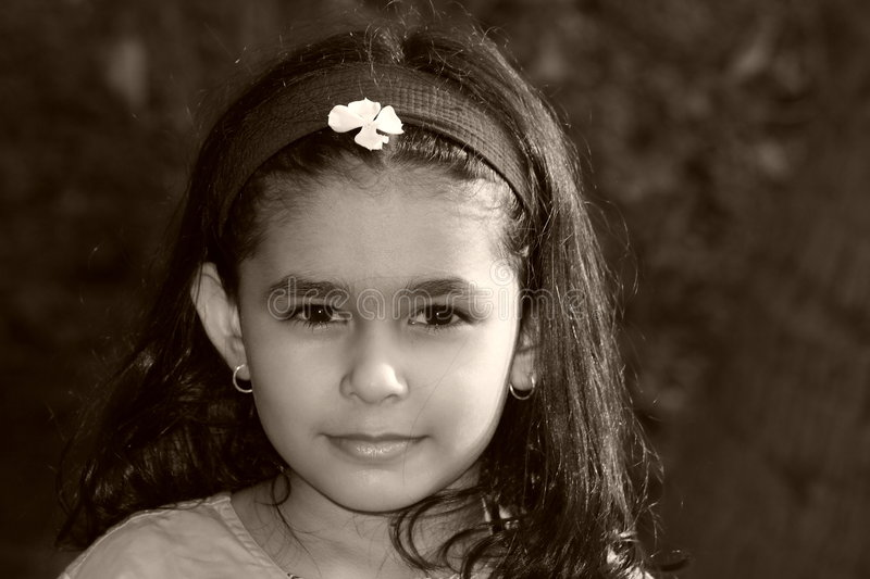 Magical Innocence. A beautiful face of a girl radiating magical childhood innocence stock image