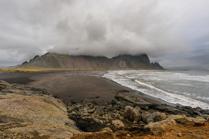 Magical landscape of Vestrahorn Mountains and Black sand dunes in Iceland at sunrise. Panoramic view of the Stokksnes headland in stock image