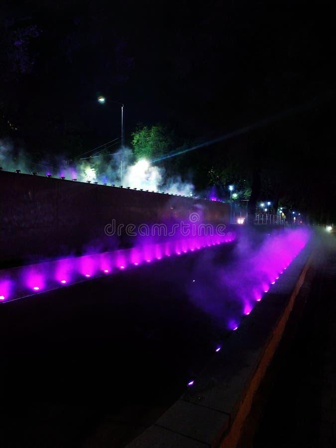 Magical night, mysterious smoke, downtown river, Halloween, purple, magic royalty free stock image