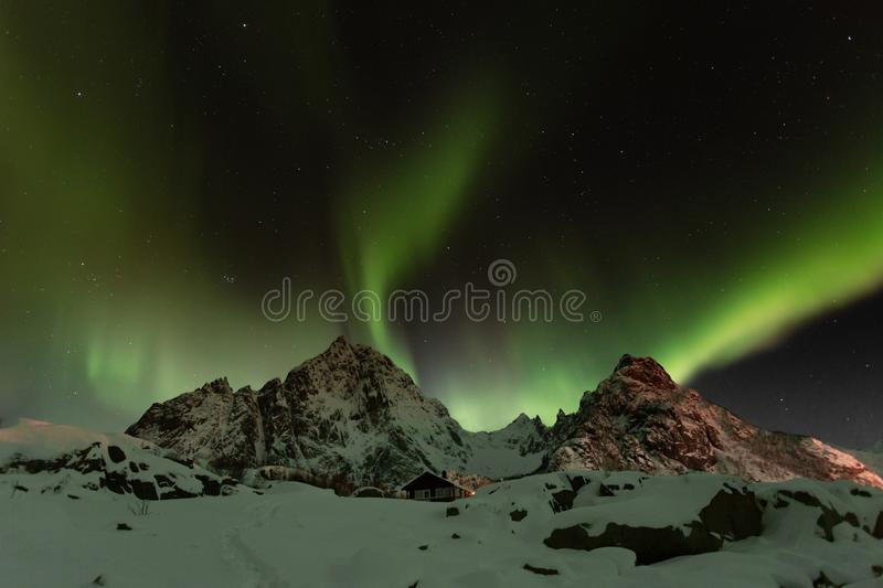 Magical northern lights in Lofoten Islands, Norway. Aurora borealis royalty free stock images