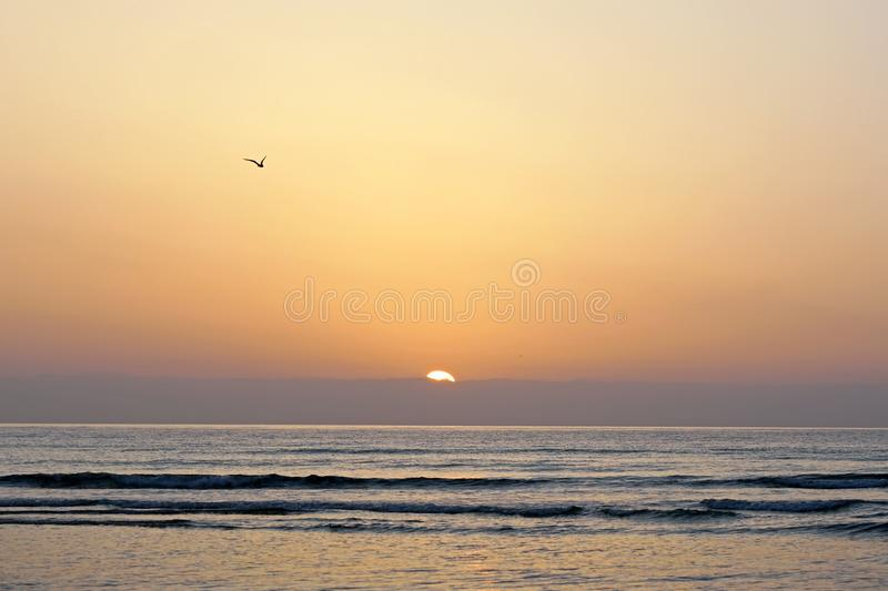 Magical ocean. Atlantic. Morning. Sunrise over the horizon. Great moments of a new day. stock photography