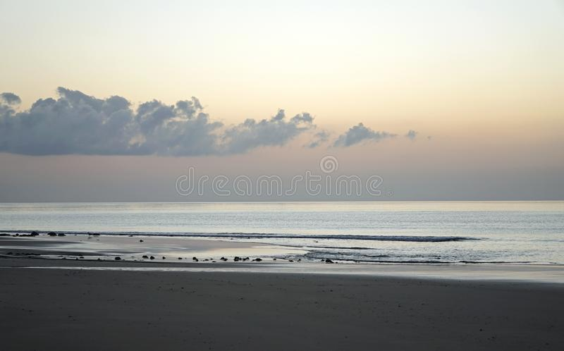 Magical ocean. Sunrise over the Atlantic. Morning. Waves of the surf. Beach royalty free stock photo
