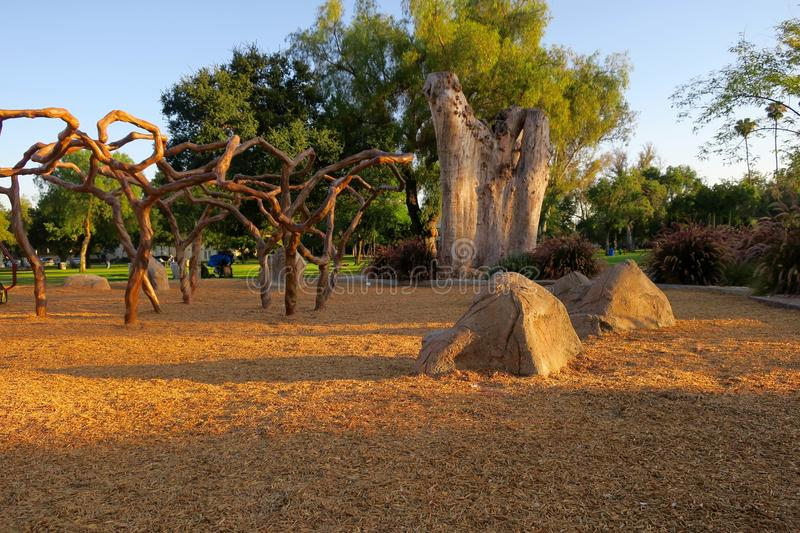 """Magical playground. Jungle gym, boulders and towering tree stump at """"Vinehenge"""", a creative, innovative theme-based playground at Grape Day Park in stock photo"""