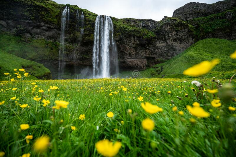 Magical Seljalandsfoss Waterfall in Iceland. It is located near ring road of South Iceland. Majestic and picturesque, it is one of the most photographed stock photo