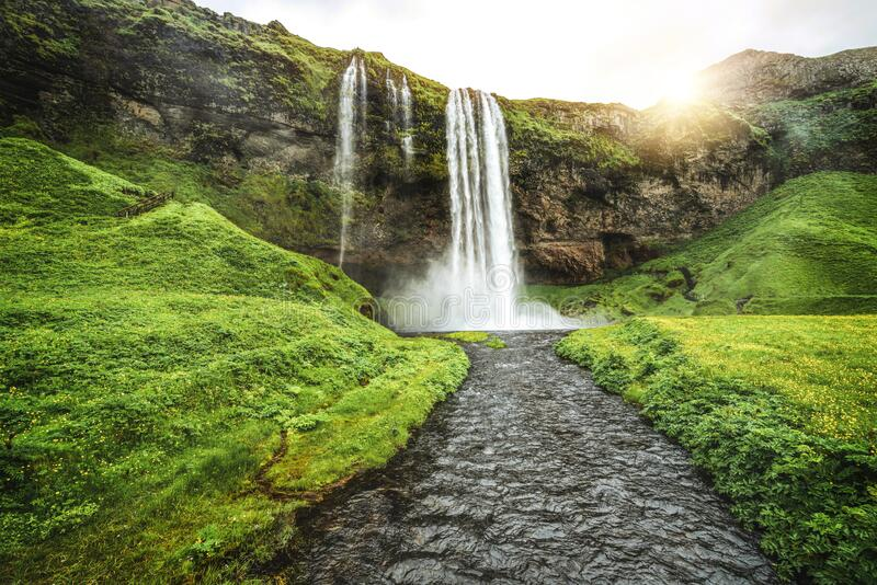 Magical Seljalandsfoss Waterfall in Iceland. It is located near ring road of South Iceland. Majestic and picturesque, it is one of the most photographed stock photography