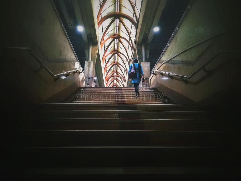 Magical solo moment. Walking towards the stairs to catch the train stock photo