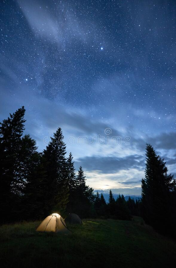 Magical starry night at a campsite in the mountains during summer time royalty free stock photography