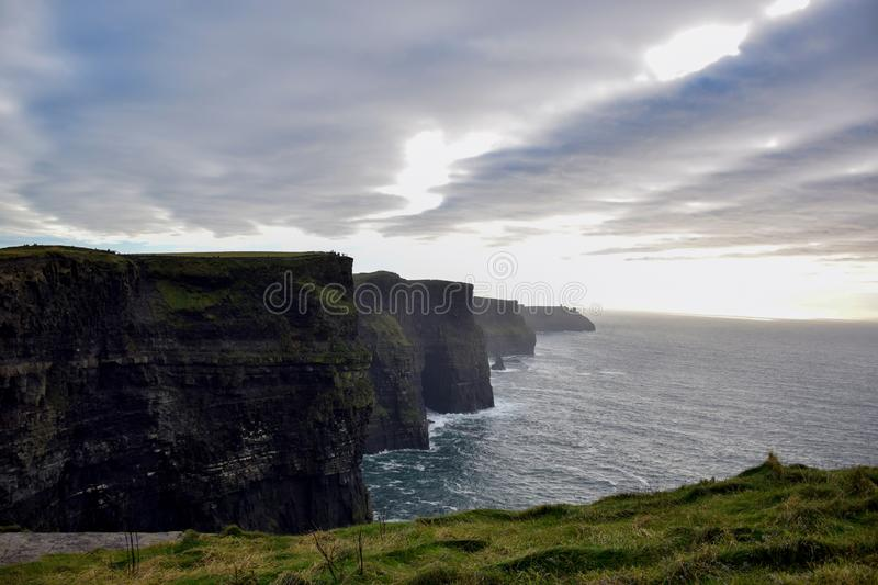 Magical sunrise on the shores of the Atlantic in Ireland near Cliffs of Moher royalty free stock images