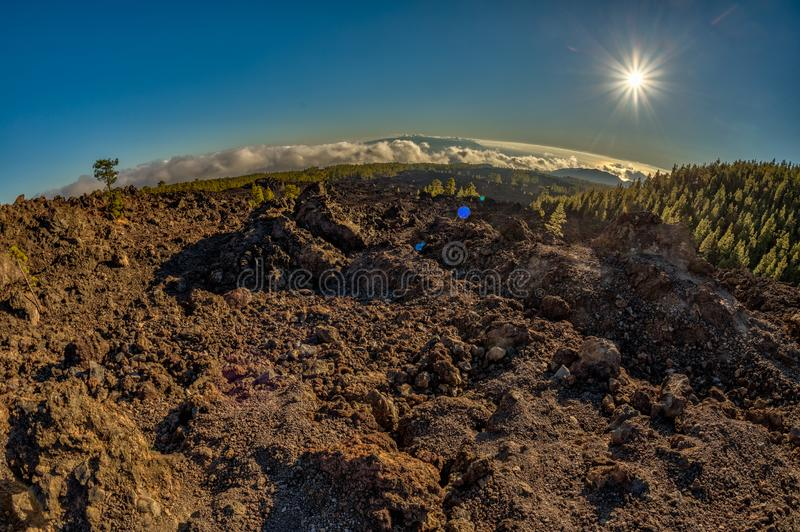 Magical sunset time above the clouds in the Tenerife mountains in Canary Islands. Fresh lava fields at 1500 meters altitude. View. Of La Gomera Island royalty free stock photography