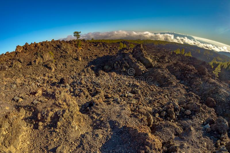Magical sunset time above the clouds in the Tenerife mountains in Canary Islands. Fresh lava fields at 1500 meters altitude. View. Of La Gomera Island royalty free stock photos