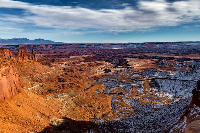 Magical winter's view of Canyonlands National Park with a layer of snow and glowing rocks. In Utah USA royalty free stock images